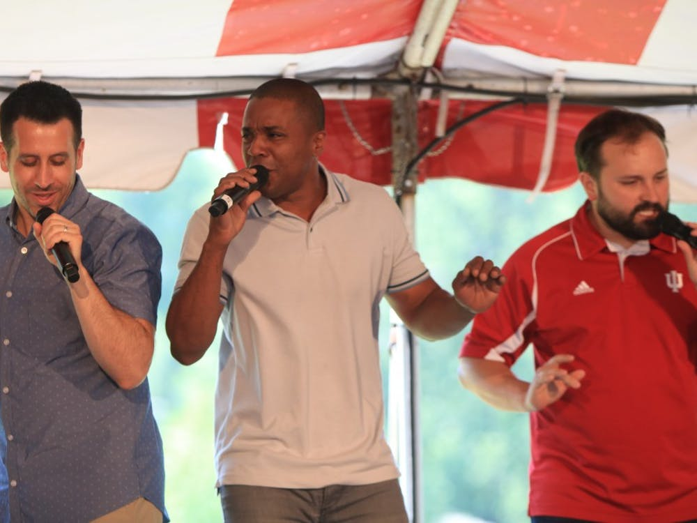 Straight No Chaser members Jerome Collins, Walter Chase and Tyler Trepp dance while performing June 9 at the IU Alumni Association luncheon and meeting outside the DeVault Alumni Center. Straight No Chaser will perform at 8 p.m. Dec. 13 at the IU Auditorium.