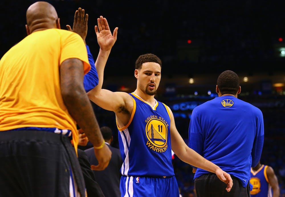 <p>Klay Thompson of the Golden State Warriors high fives teammates during the second half against the Oklahoma City Thunder on May 28, 2016, at Chesapeake Energy Arena in Oklahoma City.</p>
