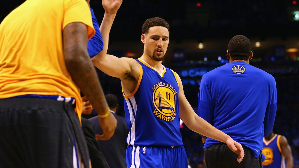 Klay Thompson of the Golden State Warriors high fives teammates during the second half against the Oklahoma City Thunder on May 28, 2016, at Chesapeake Energy Arena in Oklahoma City.