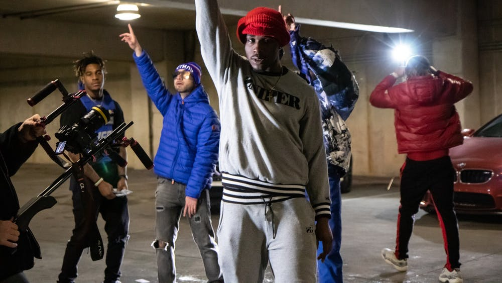 """Members of a local Bloomington rap group film their music video Feb. 27 in the Jordan Avenue parking garage. The music video was for IU senior and rapper Agboola Bankole-Hameed's song """"Next Up,""""  which comes out March 20."""