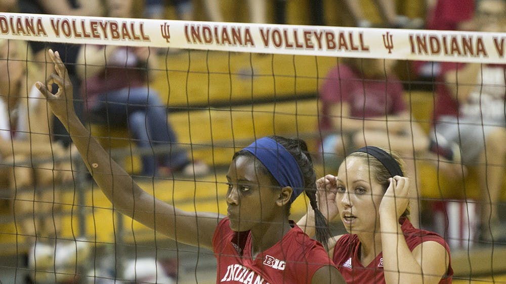 Sophomore Jazzmine McDonald, front, and sophomore Allison Hammond, back, set up a play during the Hoosier's game vs. SEMO on Sept. 6 at Assembly Hall.