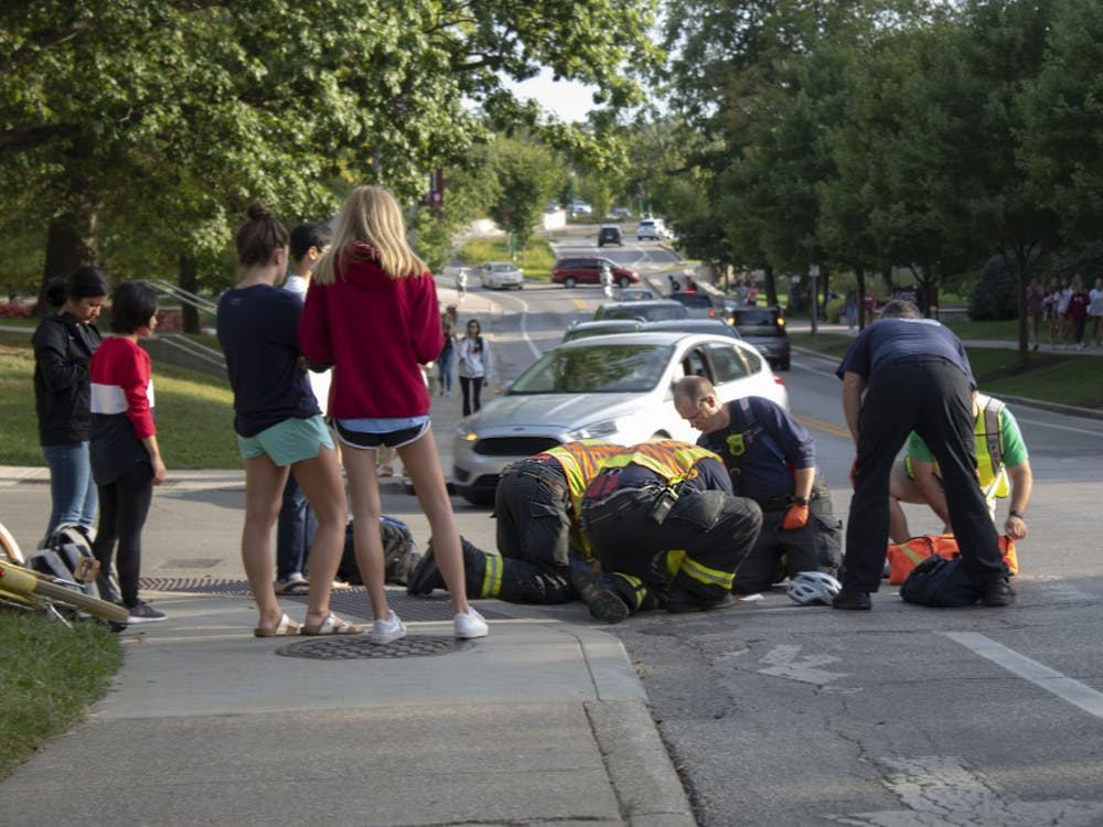 A car was hit by a bicyclist Sunday at the intersection of Seventh Street and North Jordan Avenue. The bicyclist was wearing a bike helmet, which likely prevented any serious injuries from occurring.