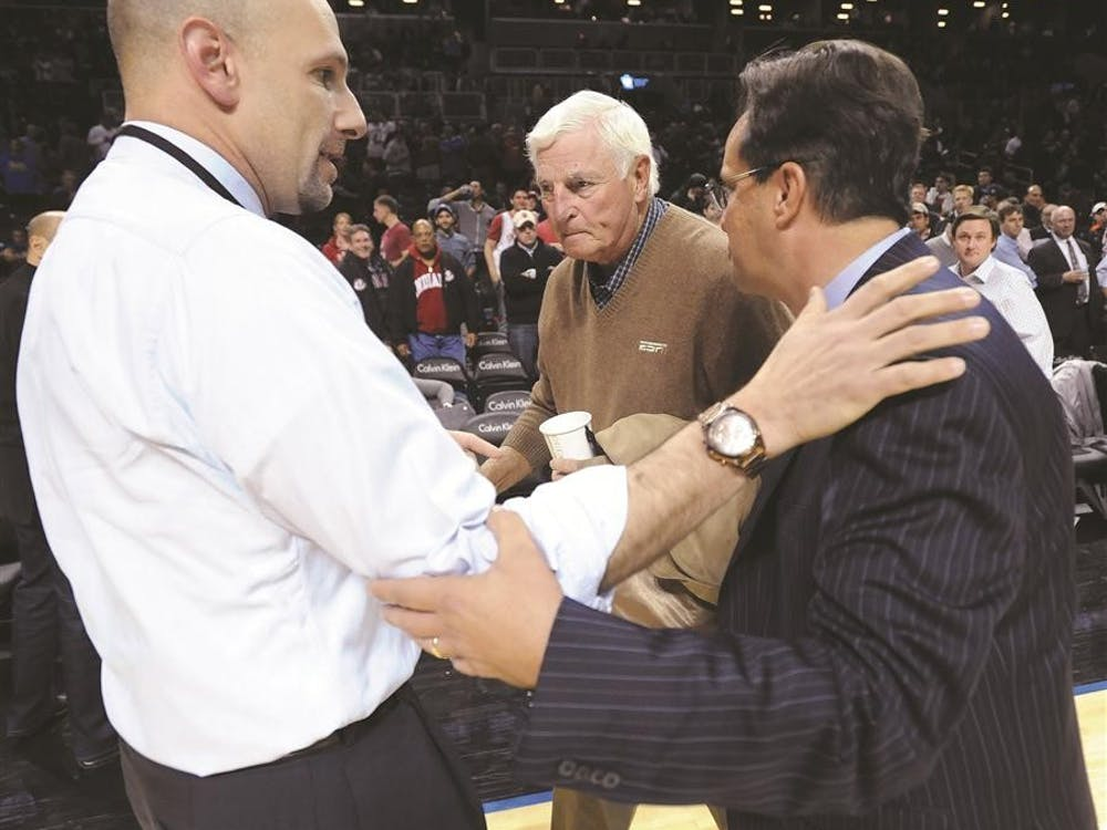 Head coach Tom Crean runs over to former head coach Bob Knight to shake his hand after the Indiana Georgia Progressive Legends Classic tournament game at the Barclay Center in Brooklyn, NY. Monday, Nov. 19, 2012. ESPN analyst Dan Shulman is at left.