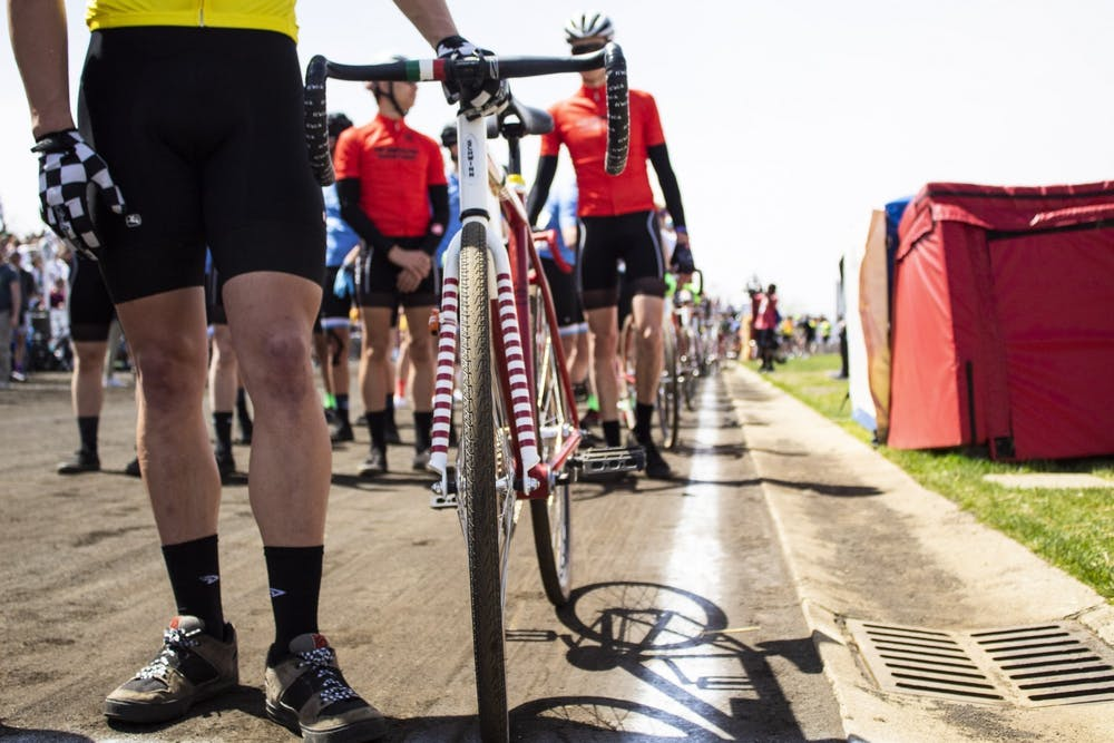 <p>Riders line up before the men&#x27;s Little 500 race April 13, 2019, at Bill Armstrong Stadium. Riders will have to wear masks when they are not riding or preparing for a change.</p>