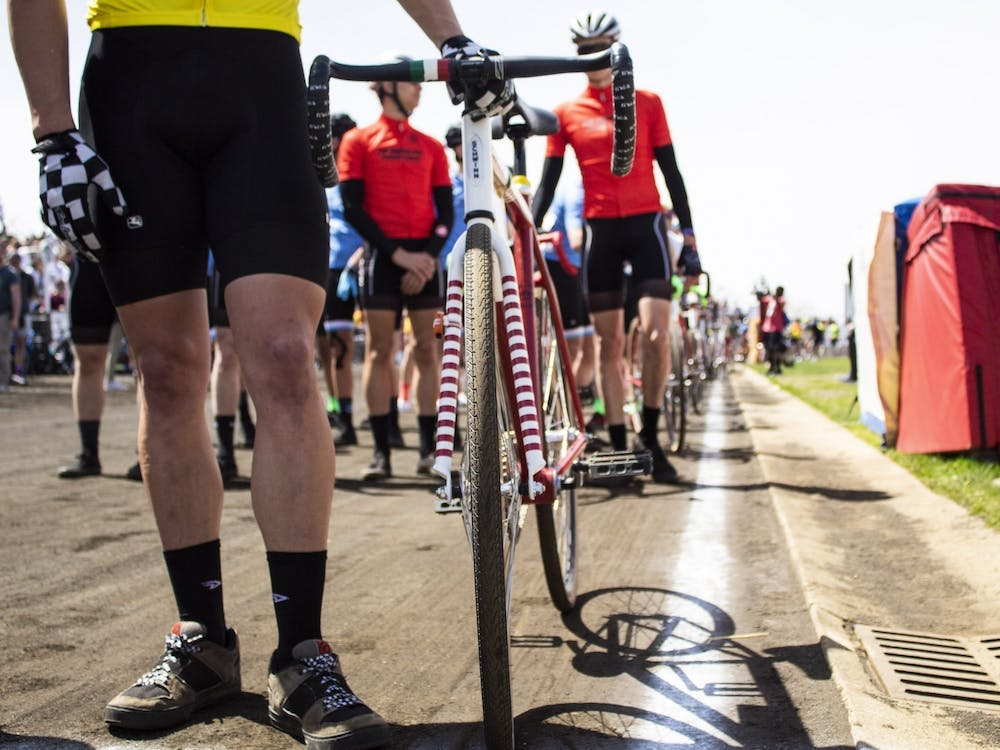 Riders line up before the men's Little 500 race April 13, 2019, at Bill Armstrong Stadium. Riders will have to wear masks when they are not riding or preparing for a change.