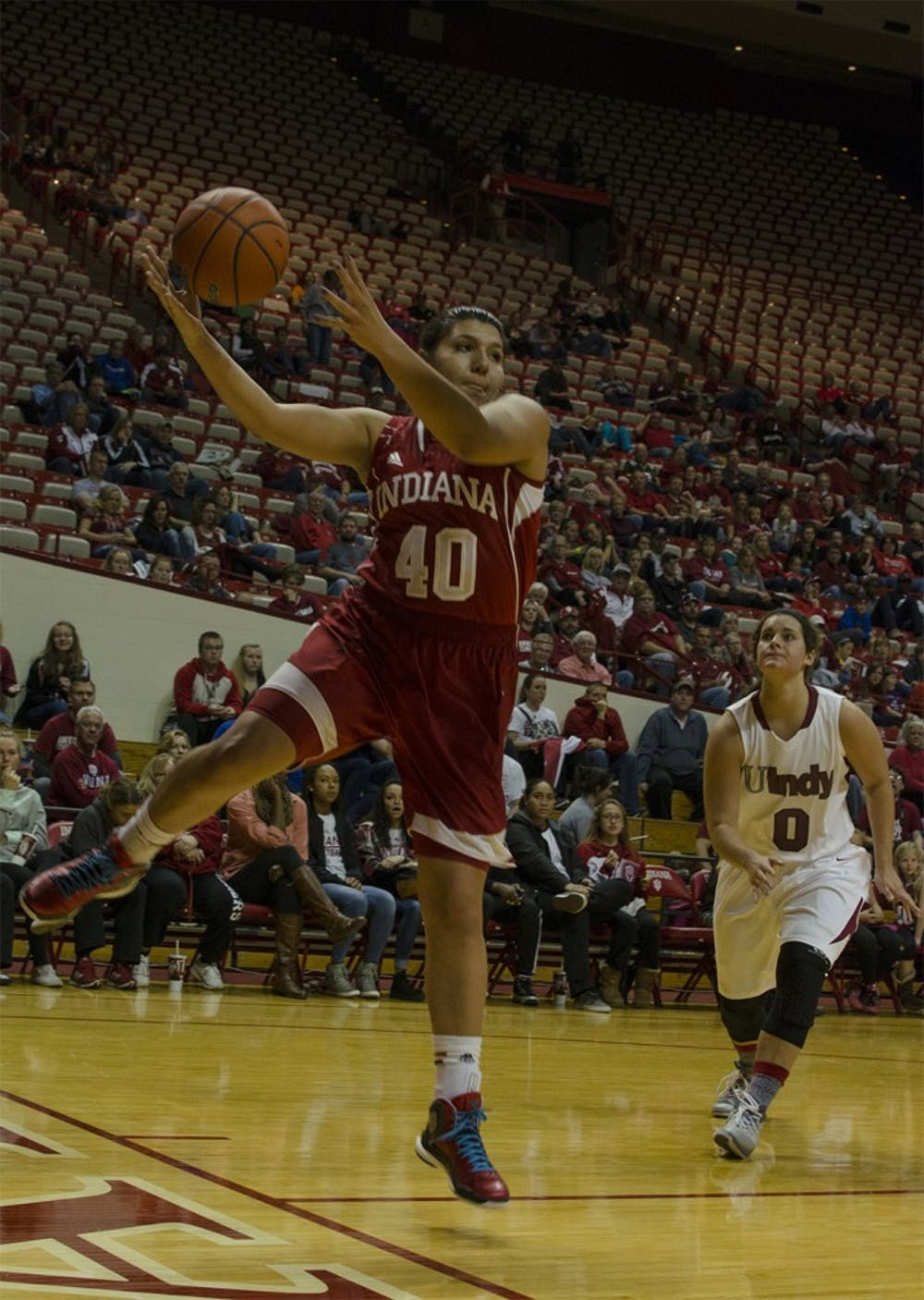 Sophomore forward Lyndsay Leikem rebounds the ball during an exhibition game against the University of Indianapolis on Nov. 9, 2014.