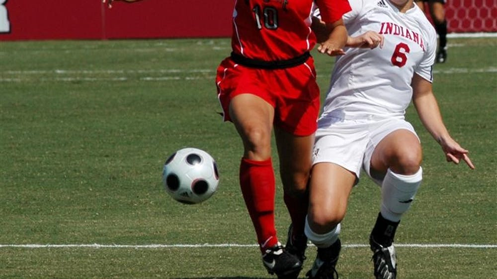 IU's Kerri Krawczak defends Paige Maxwell during a game against Ohio State on Sunday at Bill Armstrong Stadium. IU lost 1-0.