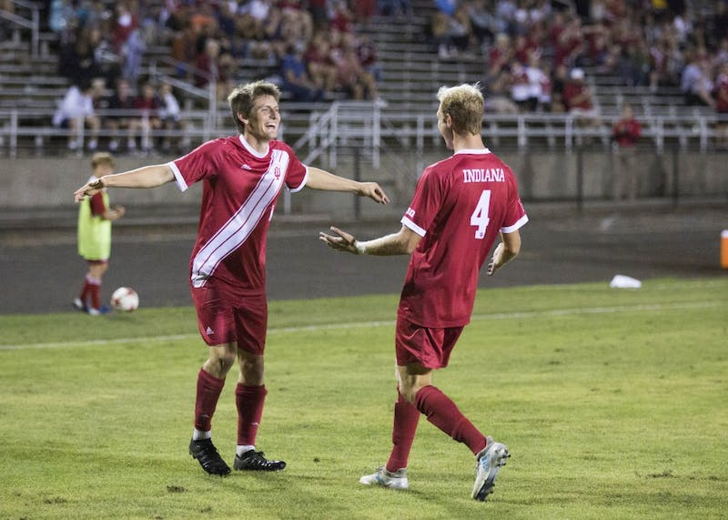 Senior Trevor Swartz celebrates with sophomore A.J. Palazzolo after IU's goal Sept. 7 at Bill Armstrong Stadium. Swartz leads the team in assists, but scored the winning goal against Rutgers on Friday.