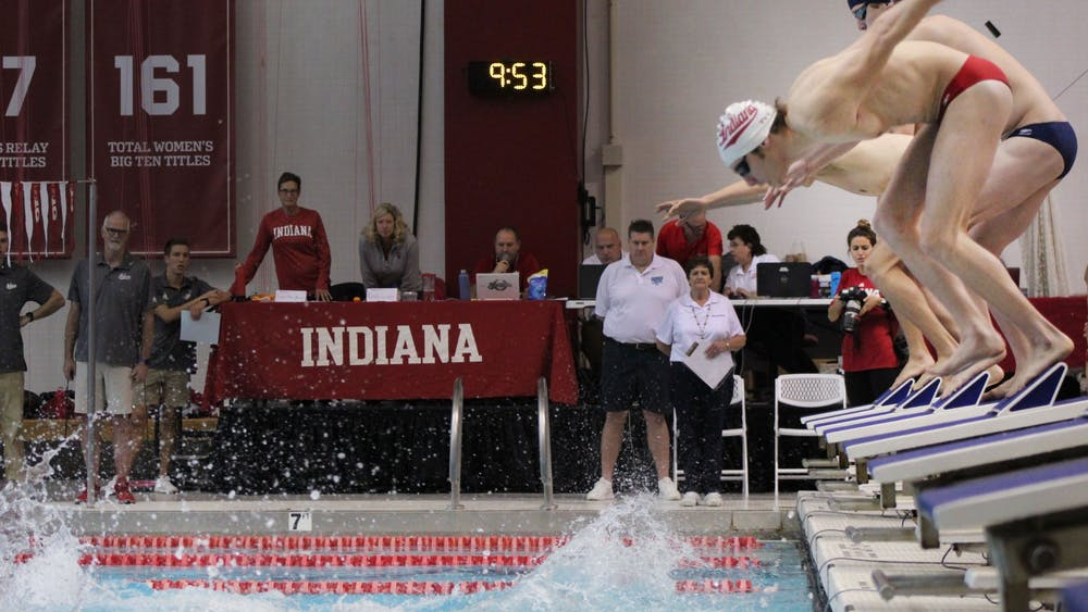 Swimmers in the men's 400 free relay kick off their starting blocks Nov. 2 at the Counsilman-Billingsley Aquatics Center. IU defeated the University of Louisville 171-129 Jan. 31 at Ralph Wright Natatorium in Louisville, Kentucky.