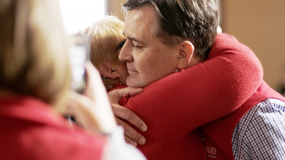 Rep. Luke Messer, R-6th District, hugs Barb Hackman, Bartholomew County Republican Party chair, after winning a Congress of Counties U.S. Senate Republican straw poll by 65 votes on Saturday. Runner-up Rep. Todd Rokita, R-4th District, received 82.