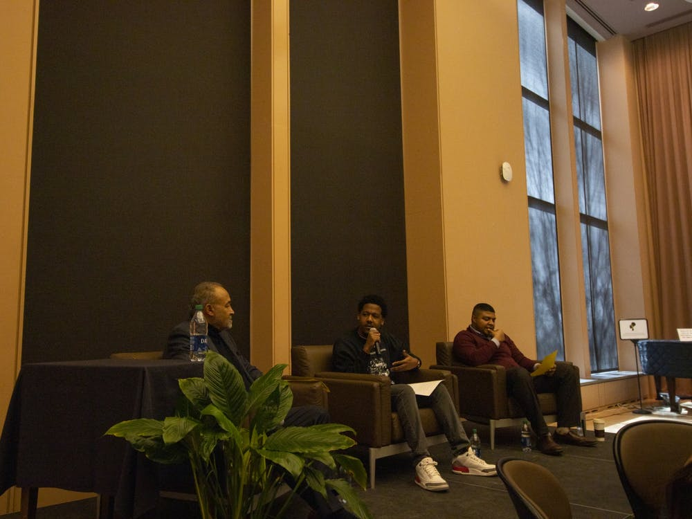 "Ph.D. candidate Donte Miller moderates a conversation about activism with IU alumni Keith Parker, left, and Leighton Johnson, right, Feb. 19 at the Neal-Marshall Black Culture Center. ""Activism wasn't a choice, it was a way of life,"" Parker said."