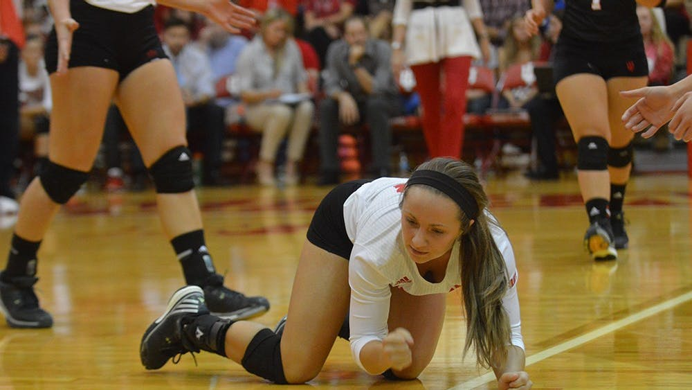 Senior defensive specialist Kyndall Merritt pounds her fist on the floor after missing a ball during the match against Purdue Wednesday evening at University Gym. The Hoosier lost to the Boilermakers 3 matches to 0.
