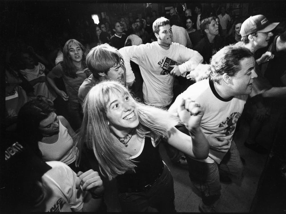 Sophomore Marni Bassichis dances to the music of Pro Midget Mafia, a ska group, at Rhino's during Lotus Festival in 1997.