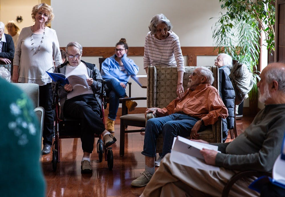 <p>Fran Gray, center, touches her husband, Jim Gray, on the arm Friday at Jill&#x27;s House in Bloomington. Jim is an accomplished artist suffering from dementia.</p>