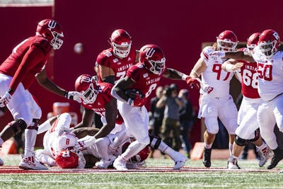 Sophomore running back Stevie Scott III defends the ball Oct. 12 in Memorial Stadium. The Hoosiers will play Maryland this weekend in College Park, Maryland.