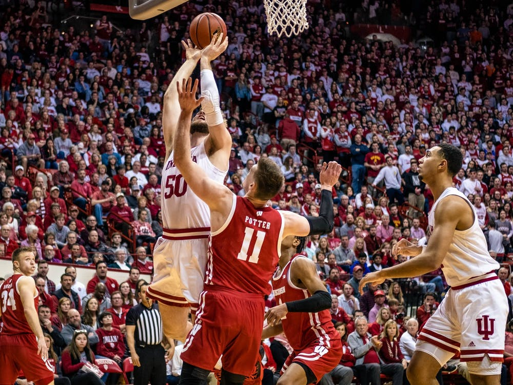 Then-red shirt junior forward Joey Brunk shoots against Wisconsin on March 7, 2020, at Simon Skjodt Assembly Hall. IU will play Michigan State on Tuesday on the road.