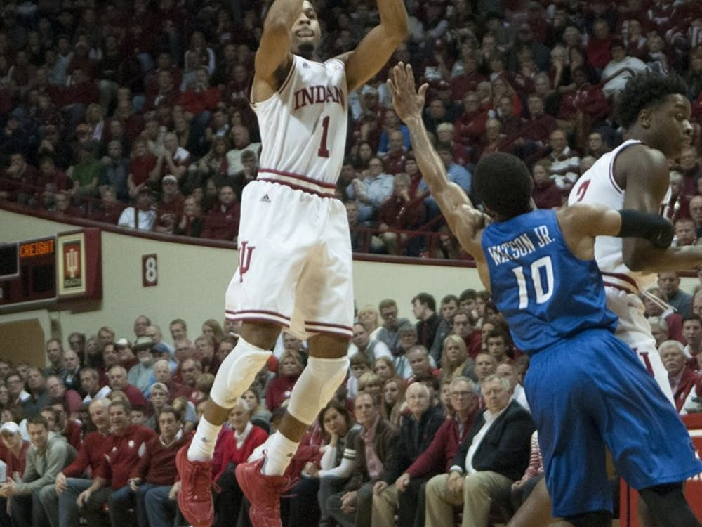 Sophomore guard James Blackmon Jr. shoots a three during the game against Creighton on Thursday at Assembly Hall.