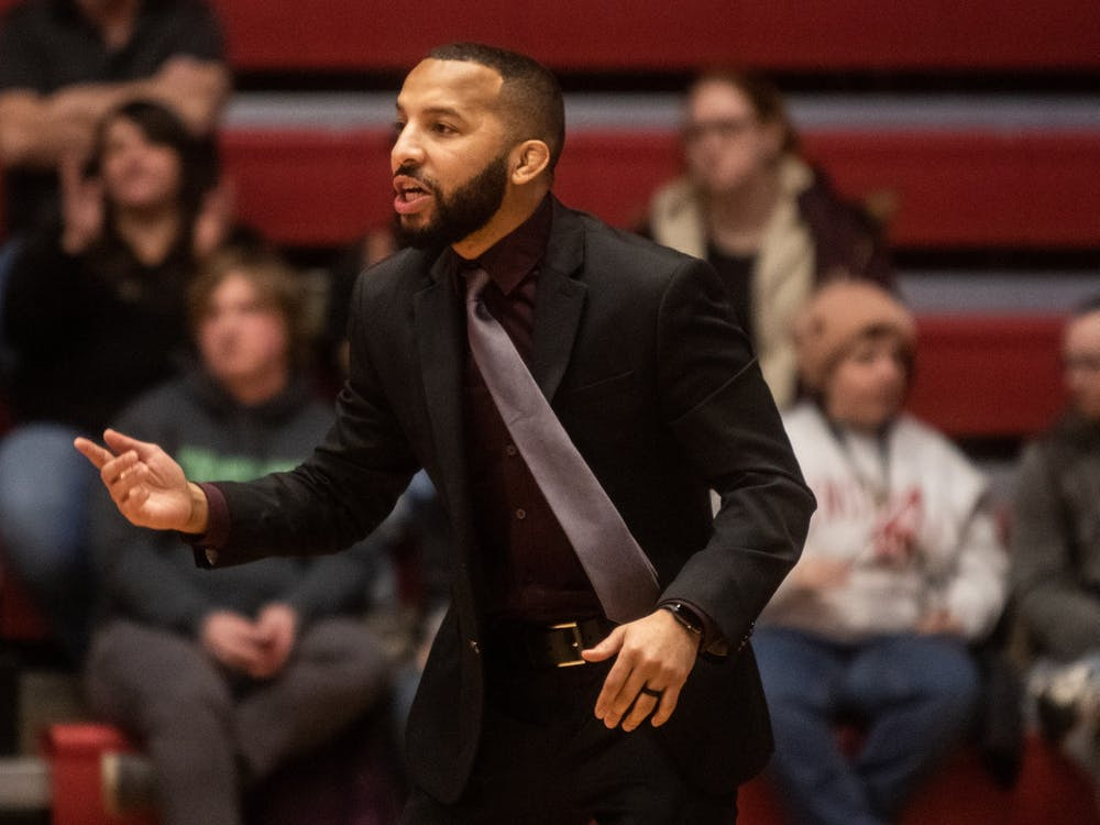 Indiana wrestling head coach Angel Escobedo coaches during the team's dual meet against Nebraska on Feb. 9, 2020. Indiana's 2021-22 schedule was released Wednesday.