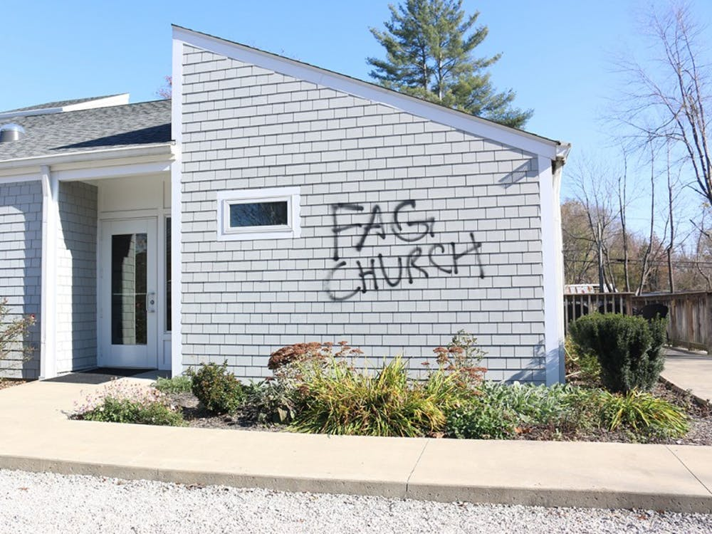 """The words """"Fag Church"""" were spray painted on the side of St David's Episcopal Church in Bloom Blossom, Ind."""