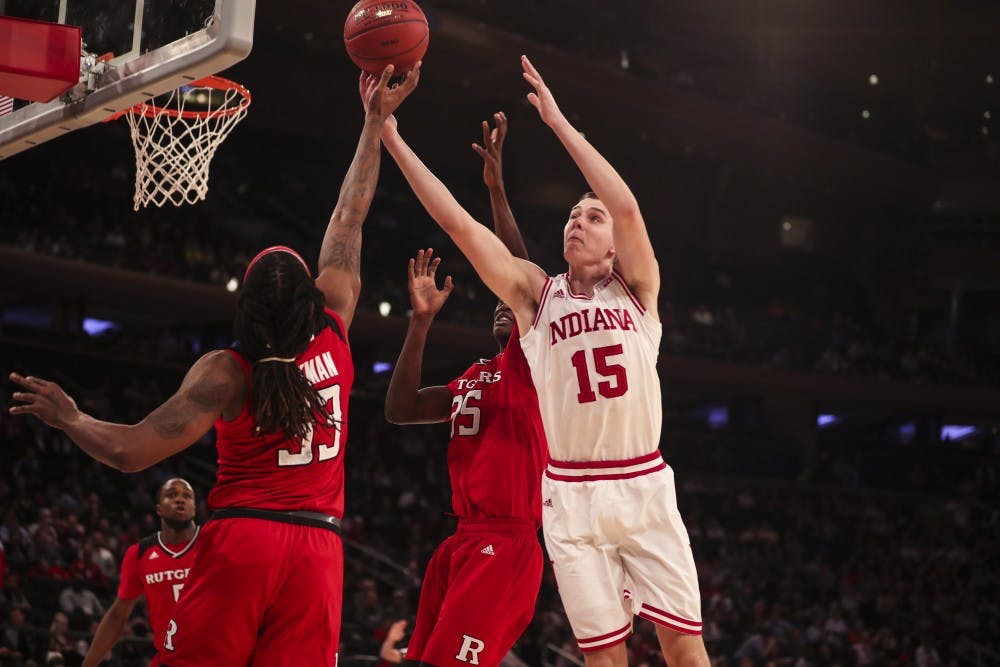 <p>Junior guard Zach McRoberts reaches for the ball during the Hoosiers' game against the Rutgers Scarlet Knights on Thursday during the Big Ten Tournament at Madison Square Garden in New York City. The Hoosiers were falling to the Scarlet Knights at halftime, 29-28.</p>