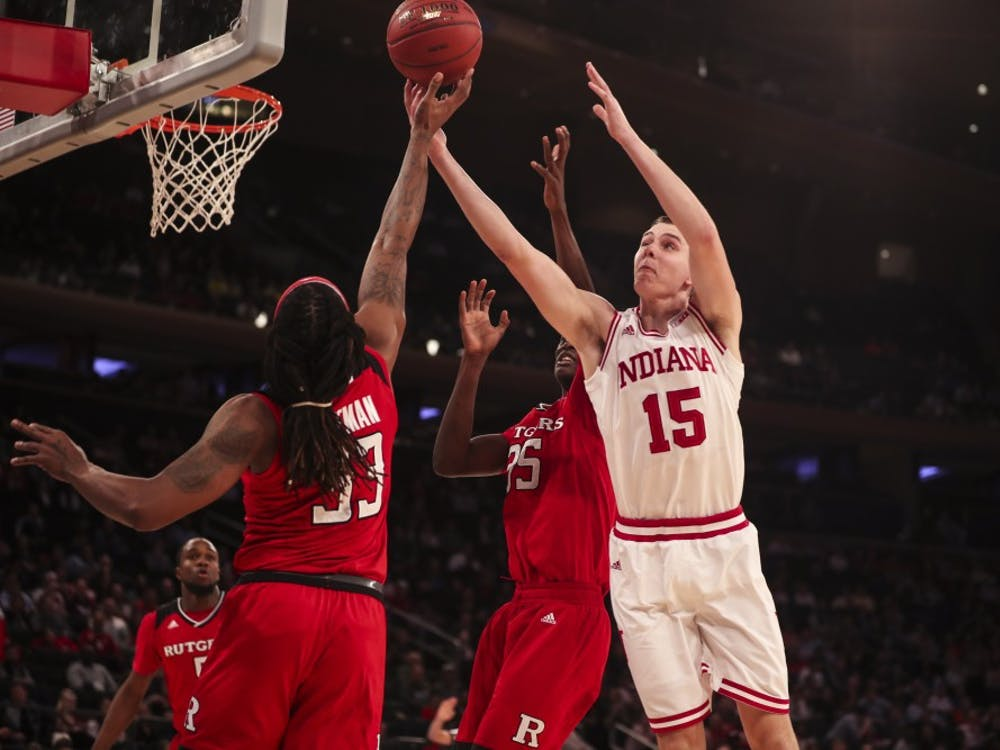 Junior guard Zach McRoberts reaches for the ball during the Hoosiers' game against the Rutgers Scarlet Knights on Thursday during the Big Ten Tournament at Madison Square Garden in New York City. The Hoosiers were falling to the Scarlet Knights at halftime, 29-28.