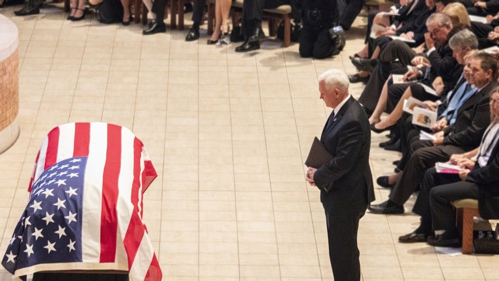 """Vice President Mike Pence stands in front of former Indiana Sen. Richard Lugar's casket May 15 in St. Luke's United Methodist Church. """"Richard Lugar lived a great American life,"""" he said."""