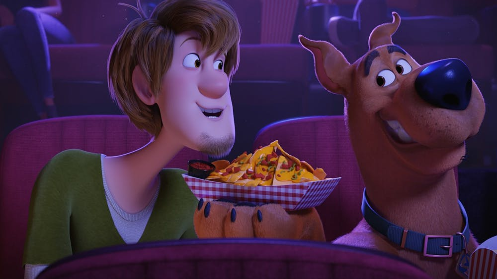 """Shaggy, left, voiced by Will Forte and Scooby-Doo, right, voiced by Frank Welker, speak to one another in """"Scoob!"""""""
