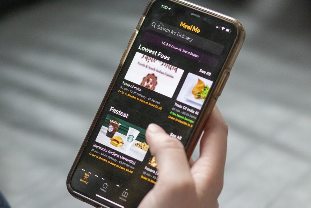 <p>The MealMe app is displayed on a phone. MealMe is an app that compares prices and times for food delivery and pickup.</p>