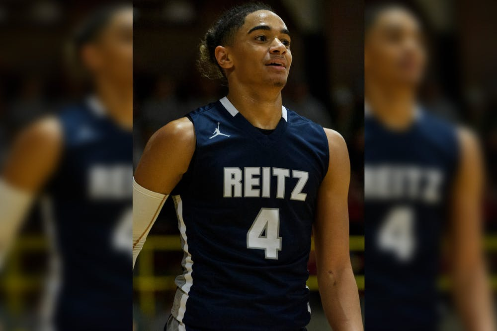 <p>Reitz's Khristian Lander takes on the Mater Dei Wildcats at Mater Dei High School in Evansville, Indiana, Friday, Dec. 13, 2019. The Panthers made a huge comeback in the fourth quarter to defeat the Wildcats, 79-73.</p>