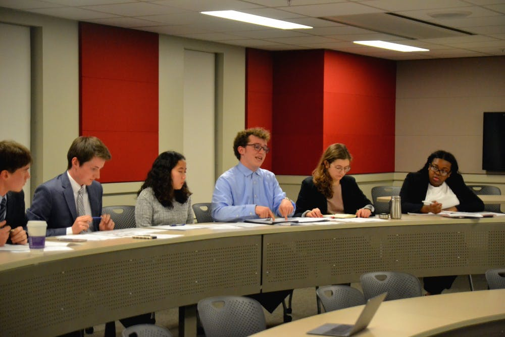 <p>Associate Justice of the IUSG Supreme Court Eli Schantz speaks Nov. 1 at the hearing of Blue Matthews v. Voice Executive Board. The hearing dealt with concerns over budgeting.</p>