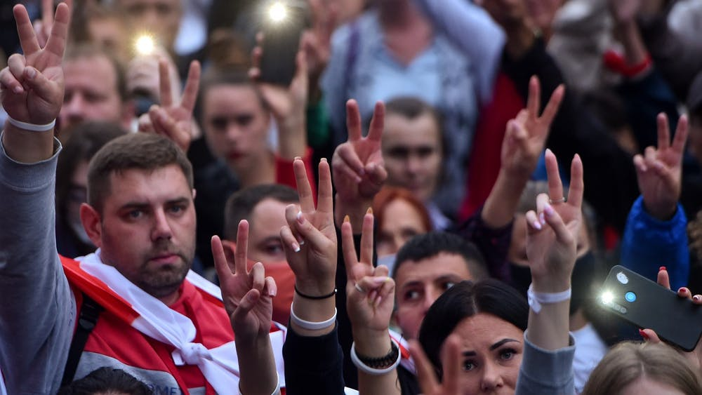 Opposition supporters gesture victory signs during a rally to protest against disputed presidential elections results Aug. 25 in Minsk, Belarus.