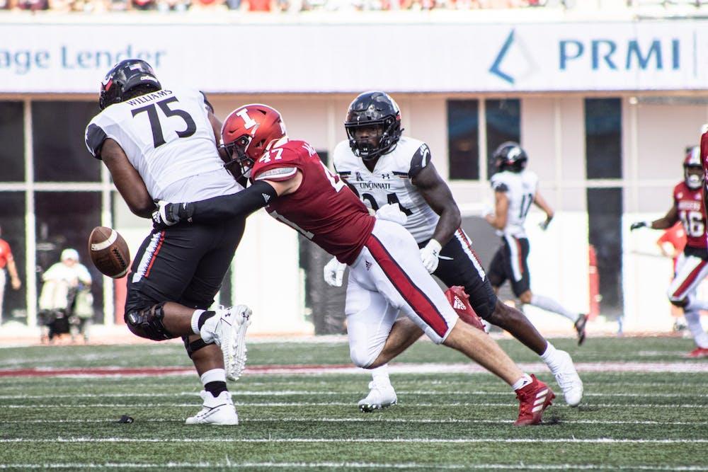 <p>Senior Micah McFadden tackles a Cincinnati Bearcats player on Sept. 18, 2021, at Memorial Stadium. McFadden had 12 tackles against Western Kentucky University.</p>