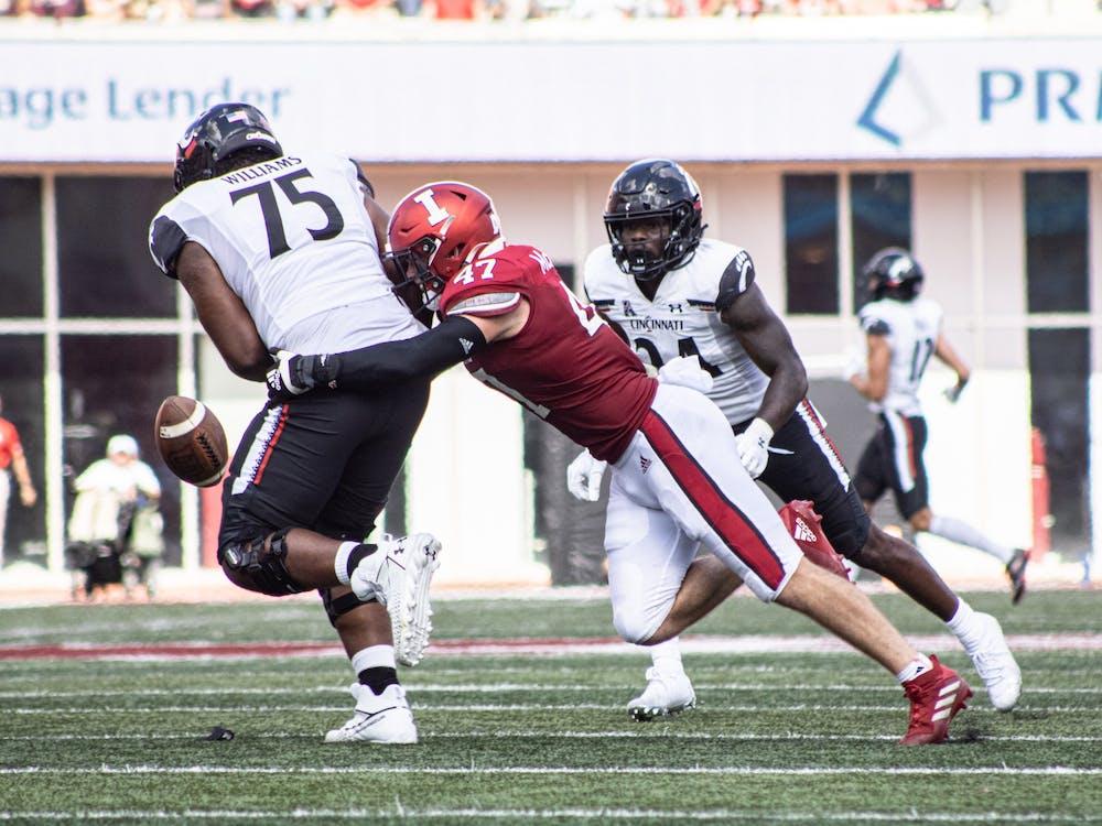Senior Micah McFadden tackles a Cincinnati Bearcats player on Sept. 18, 2021, at Memorial Stadium. McFadden had 12 tackles against Western Kentucky University.