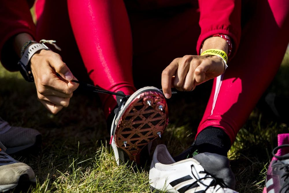 <p>An IU cross country athlete ties their shoes in October 2019. The Hoosiers competed at the 2021 NCAA Cross Country Championships on March 15, with the men&#x27;s team finishing in 26th place and the women finishing in 19th. </p>