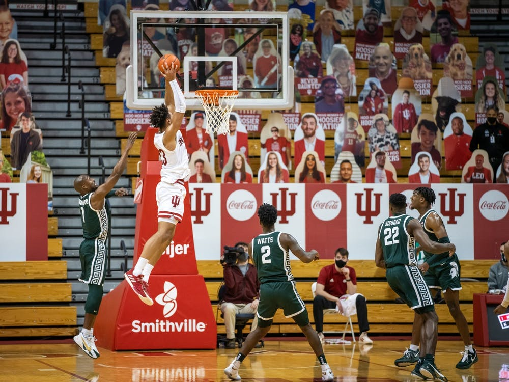 Sophomore forward Trayce Jackson-Davis catches an alley-oop pass before dunking it down Feb. 20 at Simon Skjodt Assembly Hall. Jackson-Davis was named All-Big Ten First Team by the media and All-Big Ten Second Team by the coaches on Tuesday.