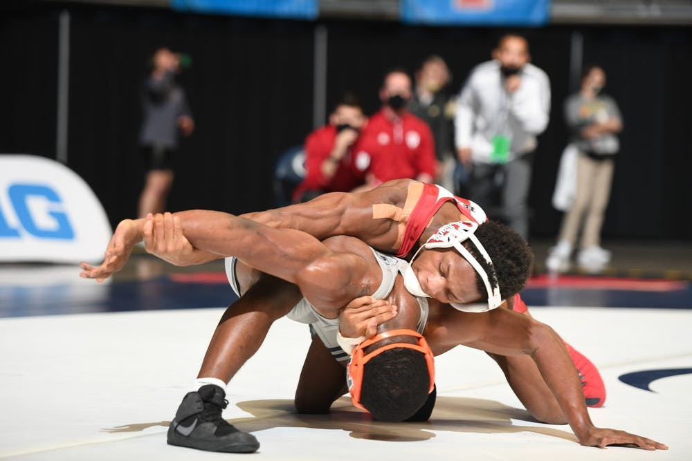 <p>Then-sophomore DJ Washington wrestles with Illinois sophomore DJ Shannon at the Big Ten Wrestling Championships in State College, Pennsylvania. Washington begins his quest for a NCAA Championship at a trial-dual meet against Bellarmine University and Southern Illinois University Edwardsville Nov. 6, 2021, in Louisville, Kentucky.</p>