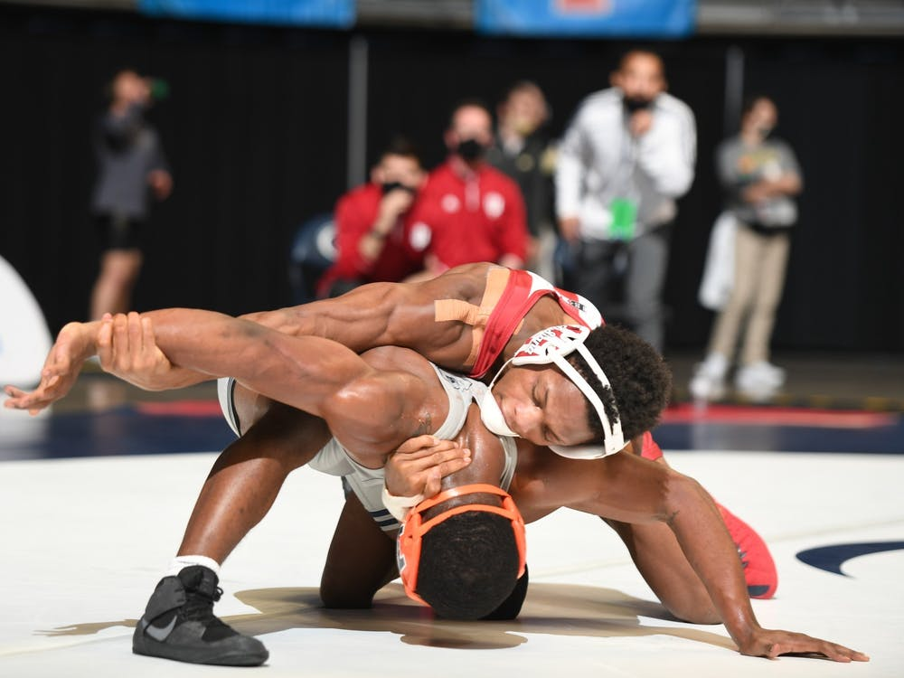 Then-sophomore DJ Washington wrestles with Illinois sophomore DJ Shannon at the Big Ten Wrestling Championships in State College, Pennsylvania. Washington begins his quest for a NCAA Championship at a trial-dual meet against Bellarmine University and Southern Illinois University Edwardsville Nov. 6, 2021, in Louisville, Kentucky.