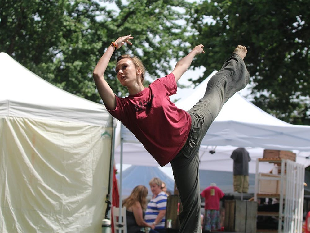 Jennifer Drettman, a Jacob's School graduate, dances with Windfall Dancers Inc. at the Arts Fair on the Square on Saturday. The fair offered a variety of art including performance, sculptures, and paintings.