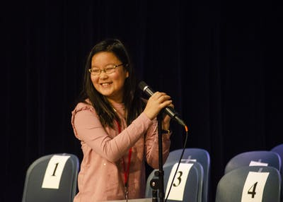 "Yena Park, 10, wins the IU Bee on Saturday in the Monroe County Public Library after spelling the word ""corollary"" correctly. Park is a fifth grader at University Elementary School in Bloomington and will compete in the Scripps National Spelling Bee in May."