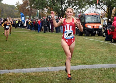 Junior Katherine Receveur celebrates as she crosses the finish line at the Big Ten Cross-Country Championships on Oct. 29 at the IU Championship Cross Country Course. Receveur won her first meet of the 2018-19 season Friday in New York.