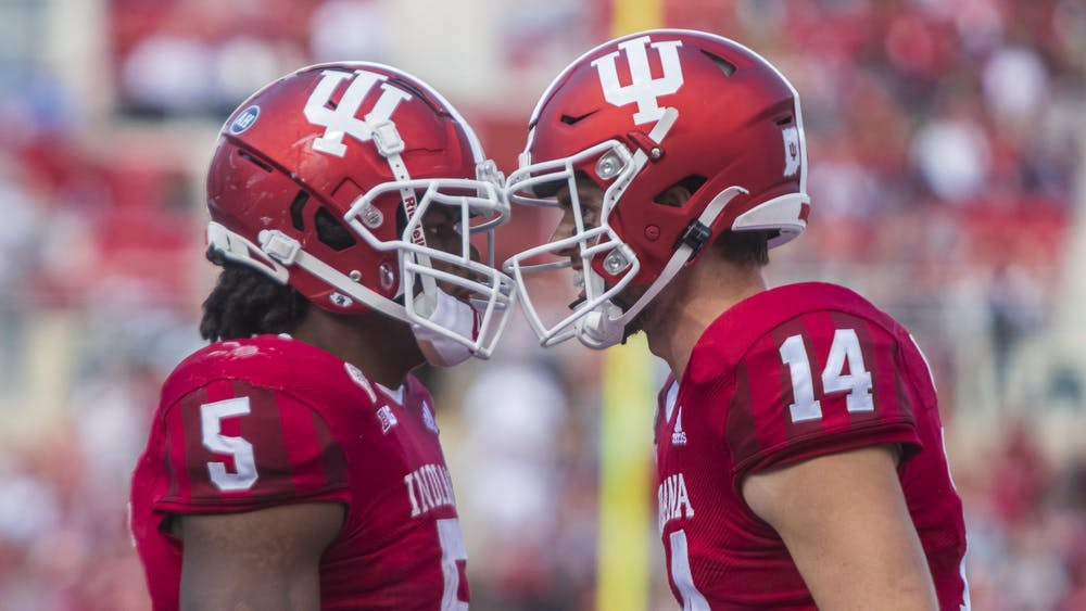Graduate running back Stephen Carr and junior quarterback Jack Tuttle celebrate Carr's touchdown Oct. 16, 2021, at Memorial Stadium. Indiana plays No. 5 Ohio State at 7:30 p.m. Saturday.