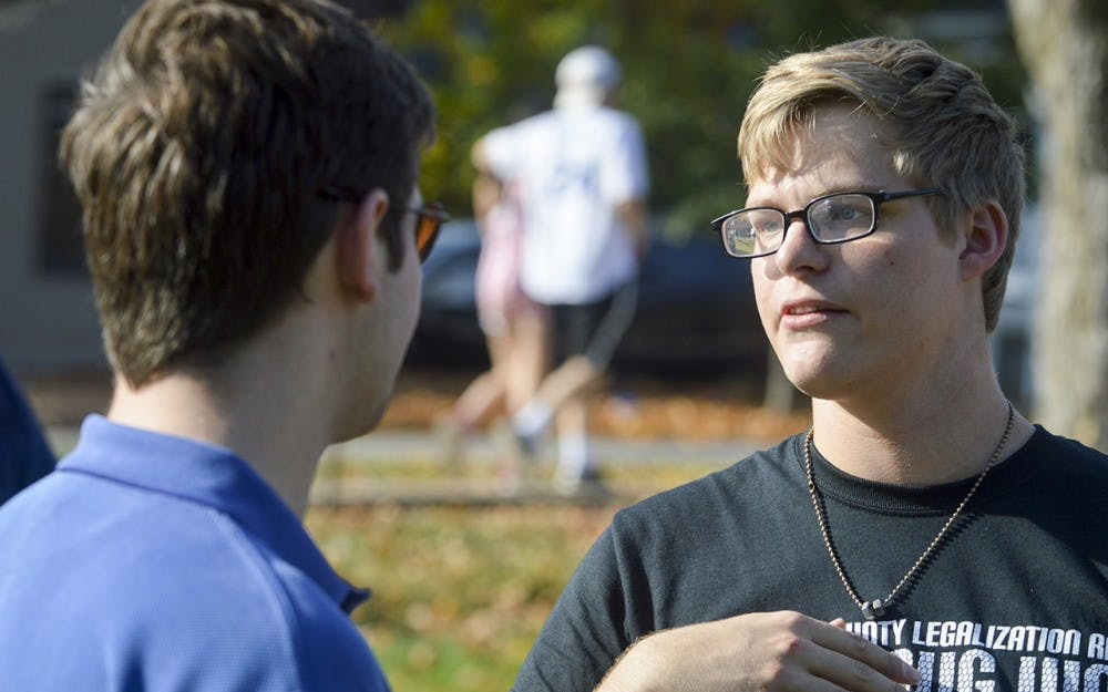 District 61 Indiana State House of Representatives candidate Drew Ash and Against PROHIBITION President Brandon Lavy discuss their views on drug reform during the Weed Legislation Rally on Saturday afternoon in Dunn Meadow. Ash states that he is in favor of the decriminalization of marijuana because of the black market that weed laws create.