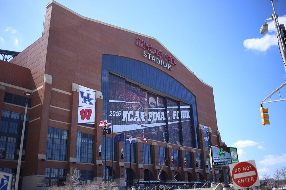 <p>Final Four signs, along with participating team logos, adorn the exterior of Lucas Oil Stadium.</p>