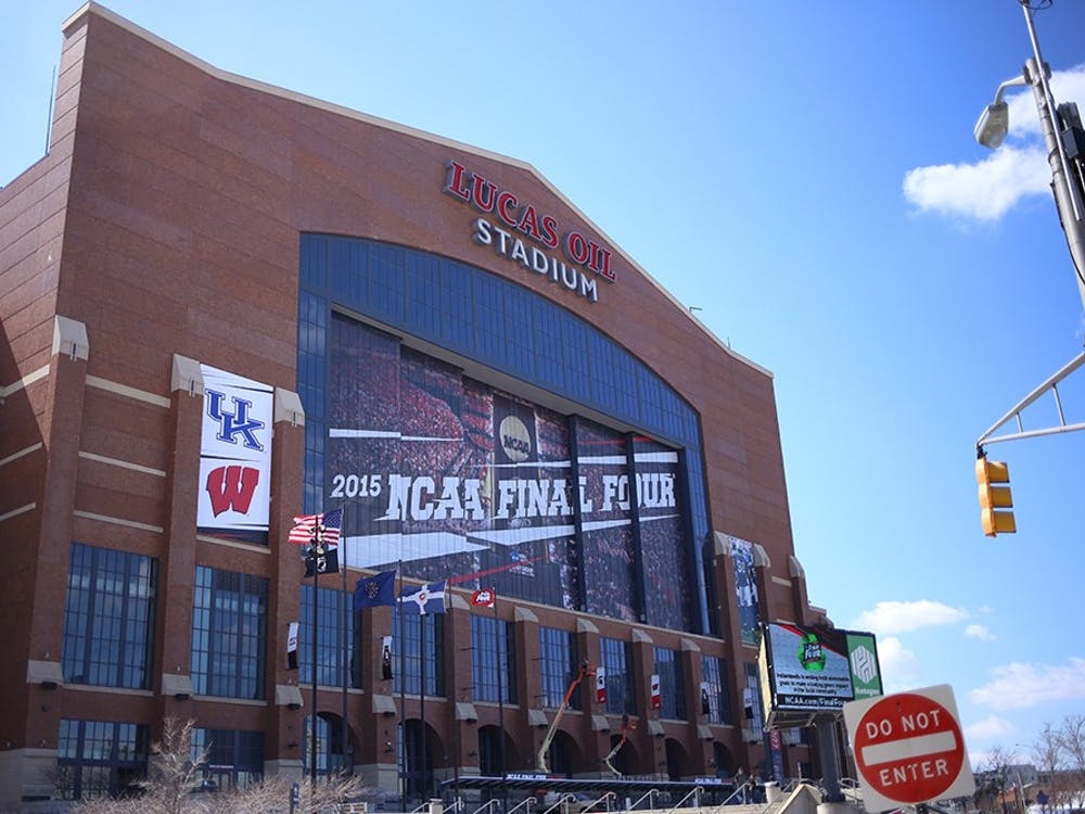 Final Four signs, along with participating team logos, adorn the exterior of Lucas Oil Stadium.