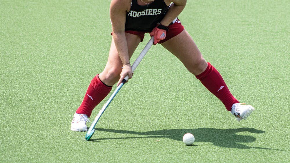 Senior Jes McGivern moves to pass the ball during the Cream/Crimson Scrimmage on Aug. 22, 2021, at the IU Field Hockey Complex. IU beat Ball State University 4-0 in a preseason exhibition.