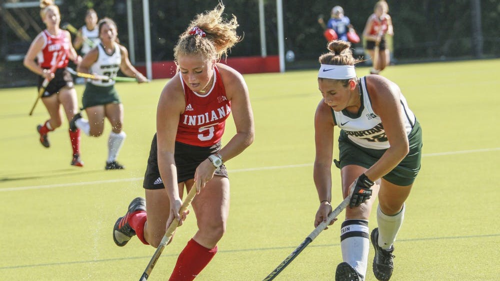 Now-sophomore forward Hailey Couch keeps the ball away from Michigan State then-senior back Baily Higgins Oct. 5 at the IU Field Hockey Complex. The Hoosiers beat the Spartans with the help of a hat trick from Couch today.