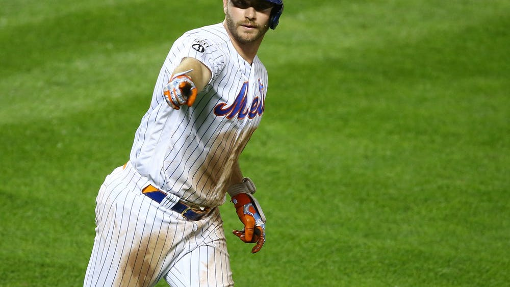 Pete Alonso of the New York Mets points to the bench after hitting a home run in the eighth inning against the Baltimore Orioles in a Sept. 9, 2020 game at Citi Field in New York City. Alonso participated in MLB's Home Run Derby on Monday.