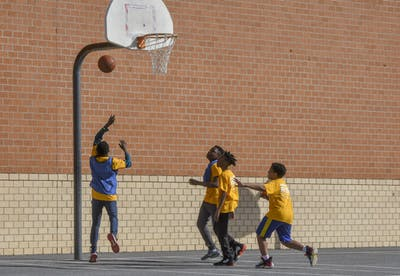 Students play a game of basketball during an after-school program Mach 10 at Murray Hill Middle School in Laurel, Maryland.