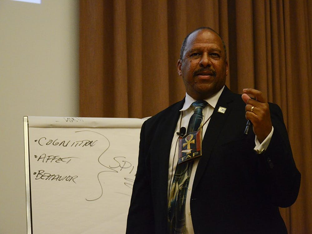 """Thomas A. Parham, Ph.D., Vice Chancellor for Student Affairs at University of California, Irvine, gives a lecture titled """"Historical Trauma & Mental Health in the African American Community"""" in the Grand Hall at the Neal Marshall Black Culture Center on Wednesday."""
