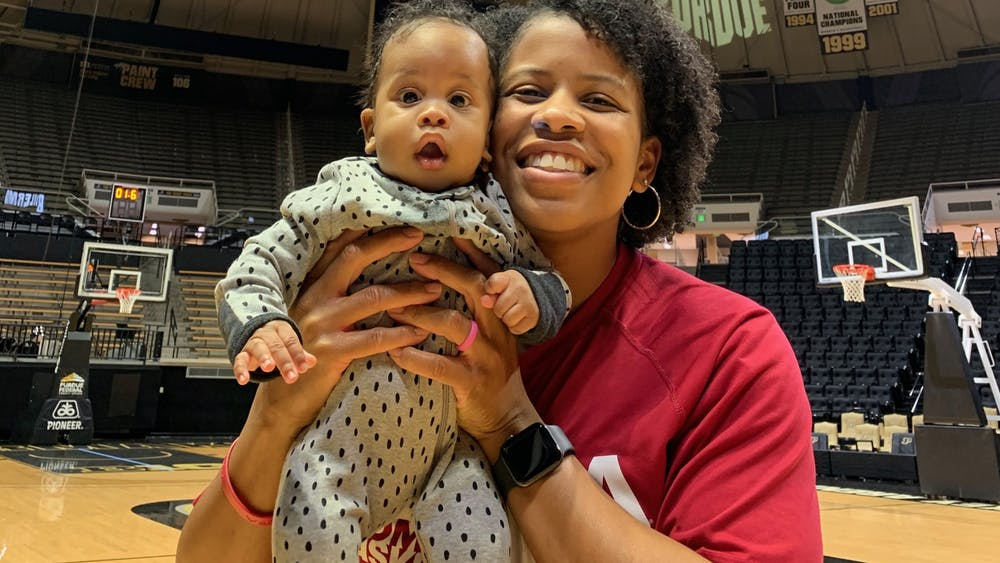 Janese Constantine holds her 6-month-old son PJ after a 66-54 women's basketball win over Purdue. IU went 8-0 on the road when PJ was in attendance.